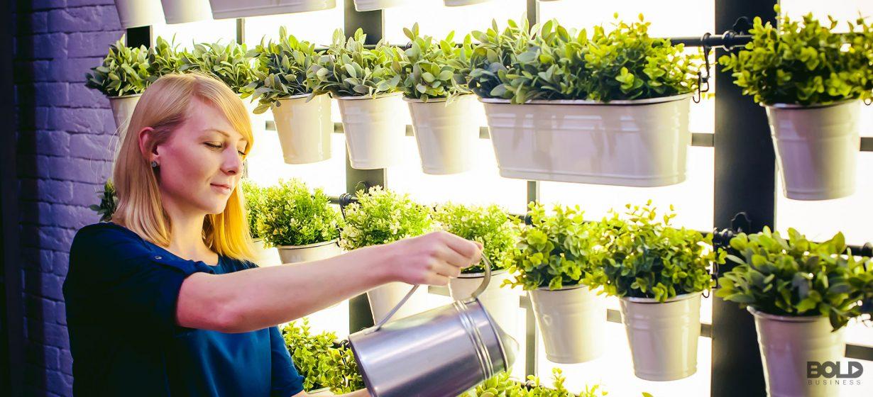 A woman watering her indoor gardening center