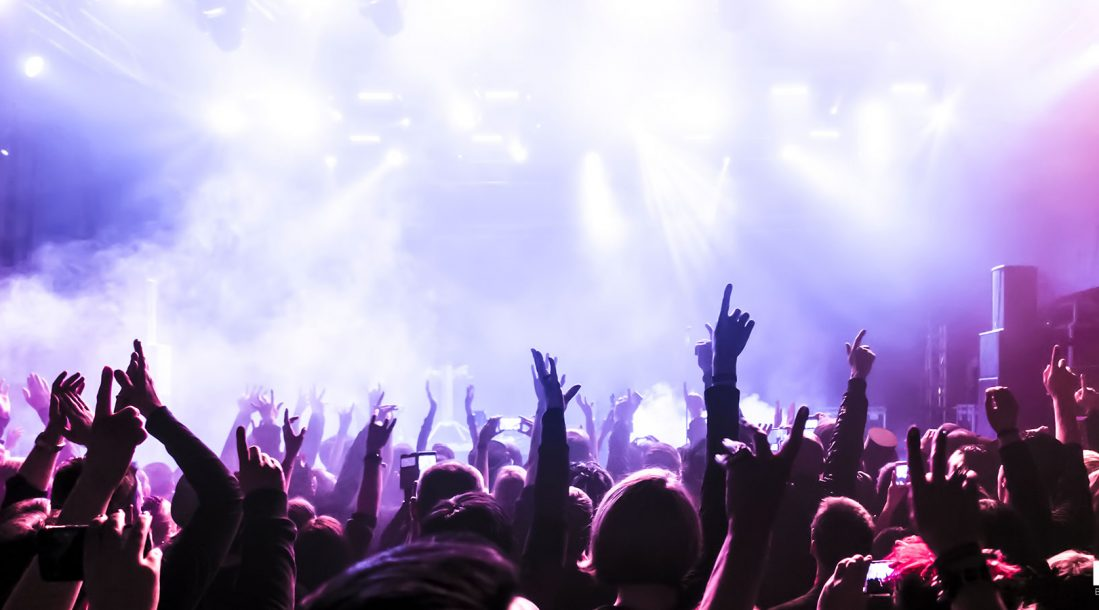 A bunch of people partying at a concert