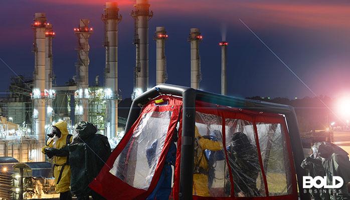 Some sort of hazmat tent set up outside a chemical plant