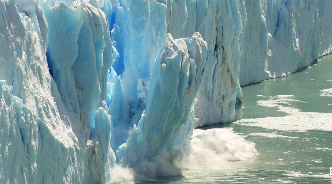 A big chunk of polar ice cap falling into the water
